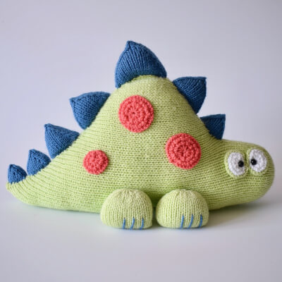Clarence the Dinosaur Toy Cushion Knitting Pattern by fluffandfuzz