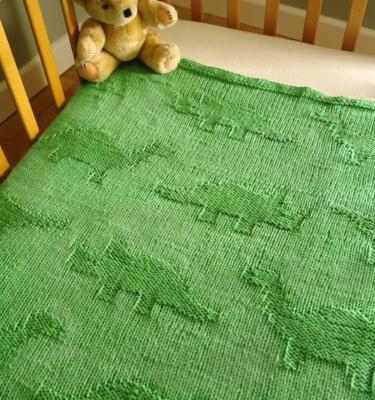 Easy Baby Blanket Dinosaur Knitting Pattern by SprogletsKits
